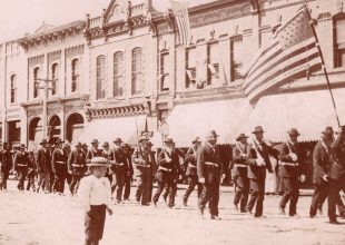 Historic photo showing a memorial day parade through alexandria, MN in 1903