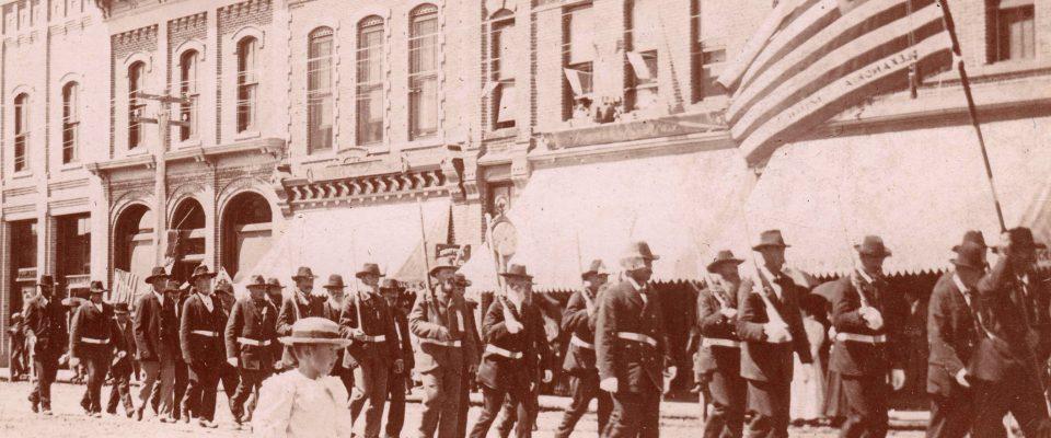 Historic photo showing a memorial day parade through alexandria, MN in 1903